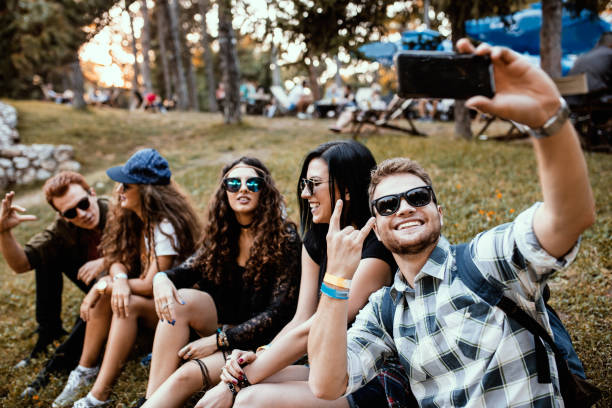 Group of friends taking selfie at Summer music festival stock photo