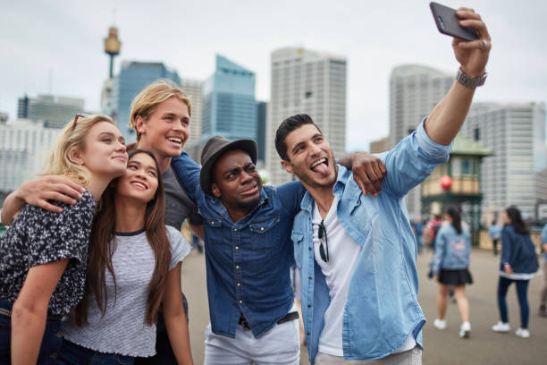 Group of friends taking selfie on smart phone stock photo
