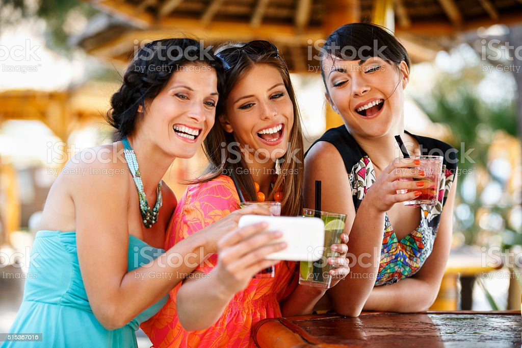 Group of friends taking selfies at the party​​​ foto