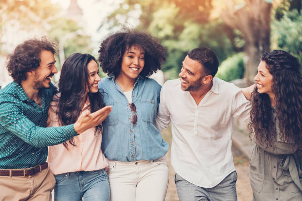 Group of friends talking and laughing stock photo