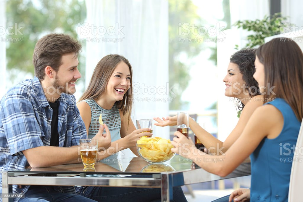 Group of friends talking at home stock photo