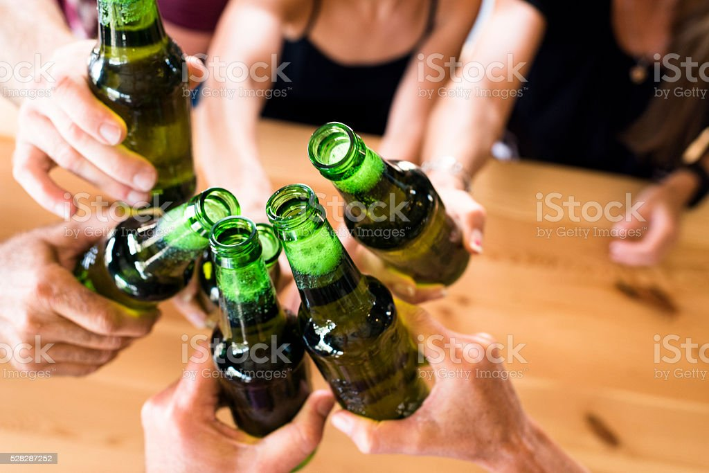 Group Of Friends Toasting At An Indoor Brewery stock photo