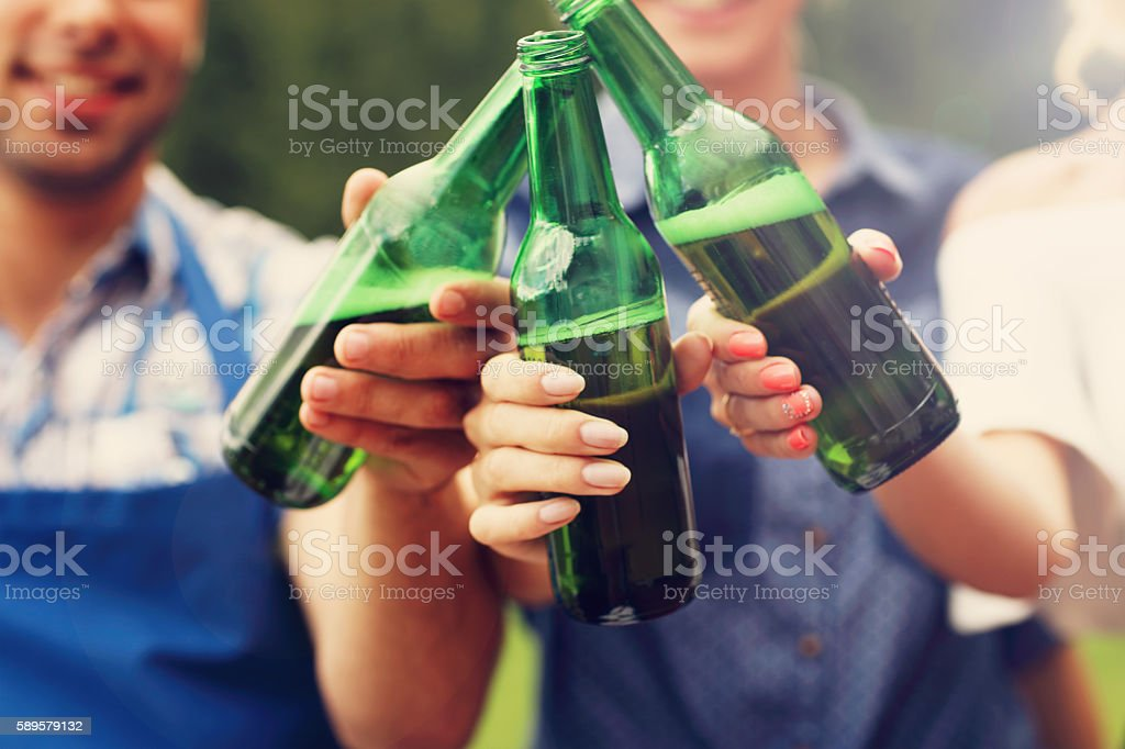 Group of friends toasting beer stock photo