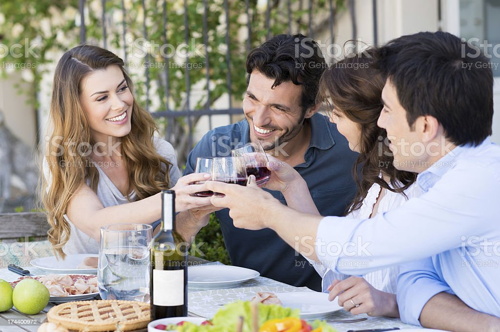 Group Of Friends Toasting Wine Glass stock photo