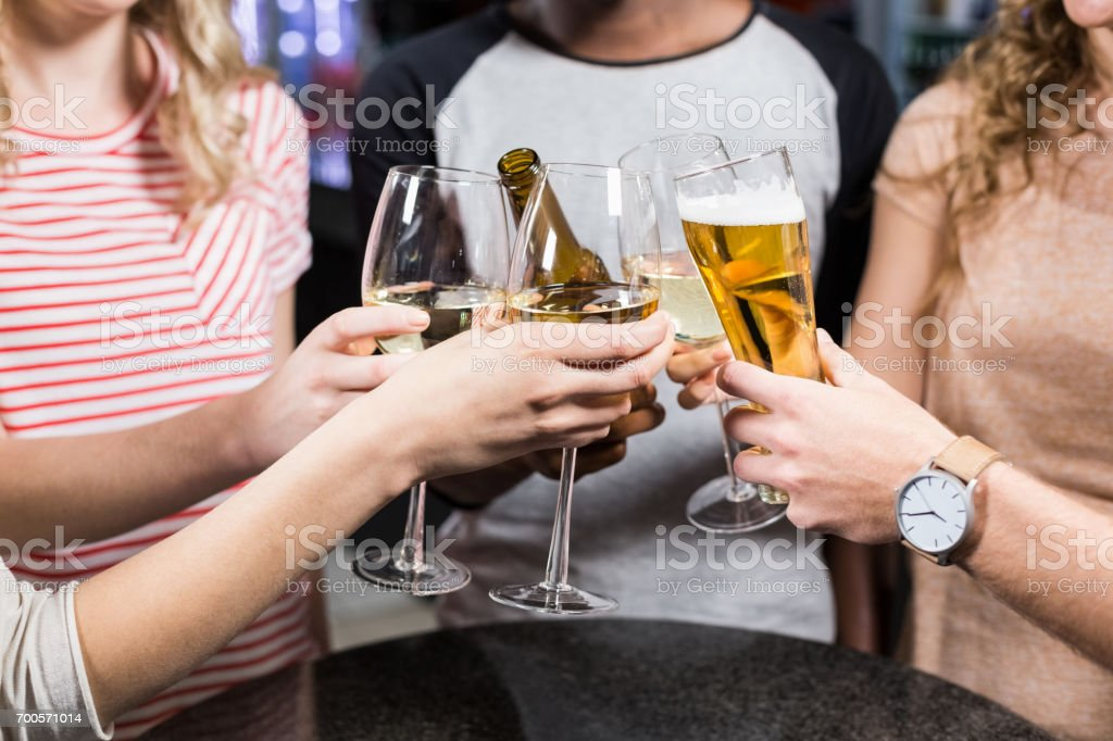 Group of friends toasting with beer and wine stock photo
