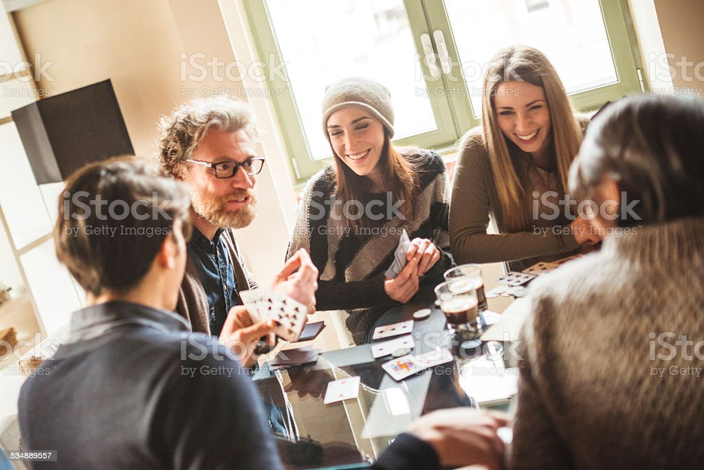group of friends toasting with drinks at home stock photo