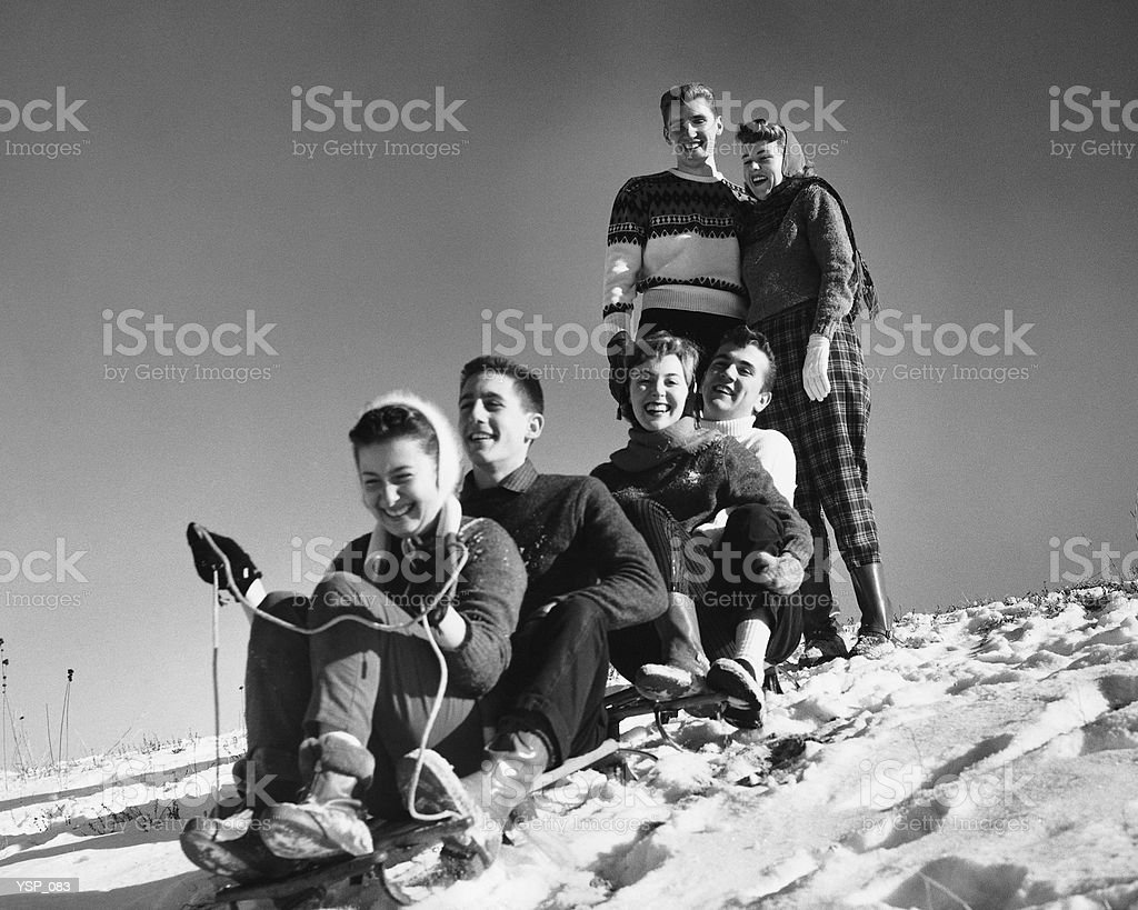 Group of friends tobogganing royalty-free stock photo