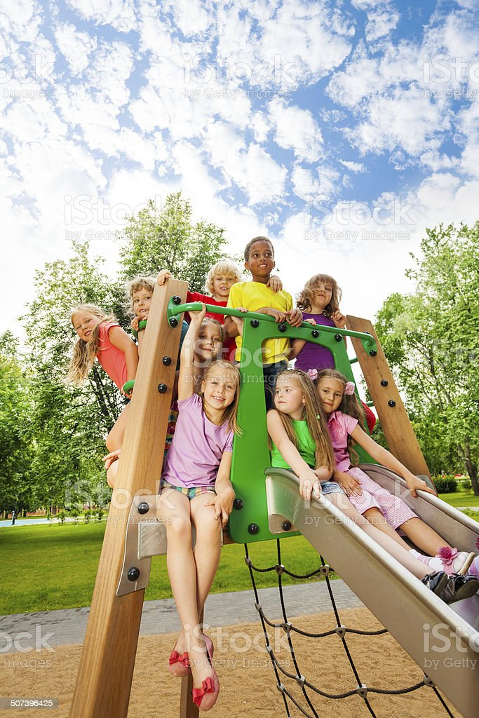 Group of friends together on a chute in summer stock photo