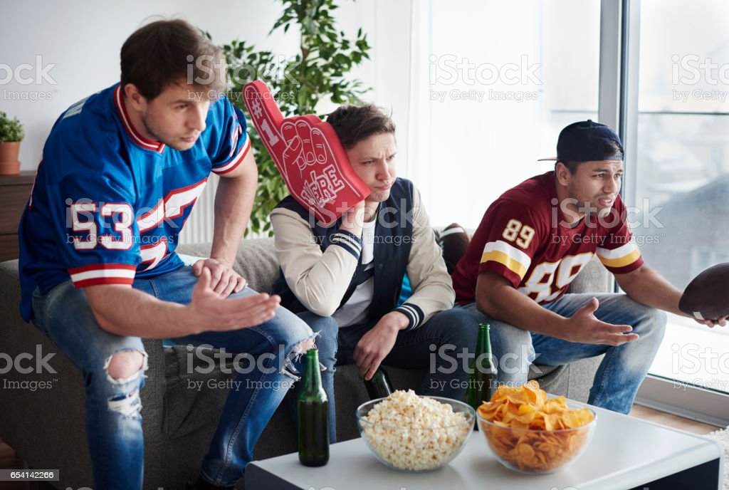 Group of friends together supporting football team stock photo