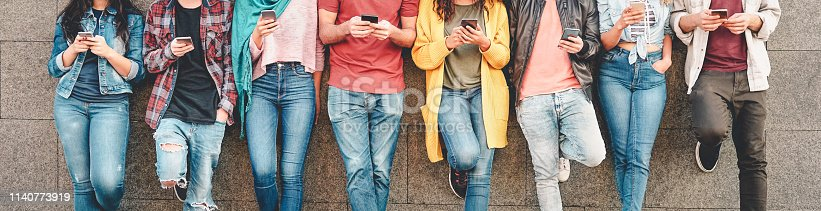 Group of friends using their smart mobile smartphones outdoor - Millennial young people addicted to new technology trends apps - Concept of people, tech, social media, generation z and youth lifestyle
