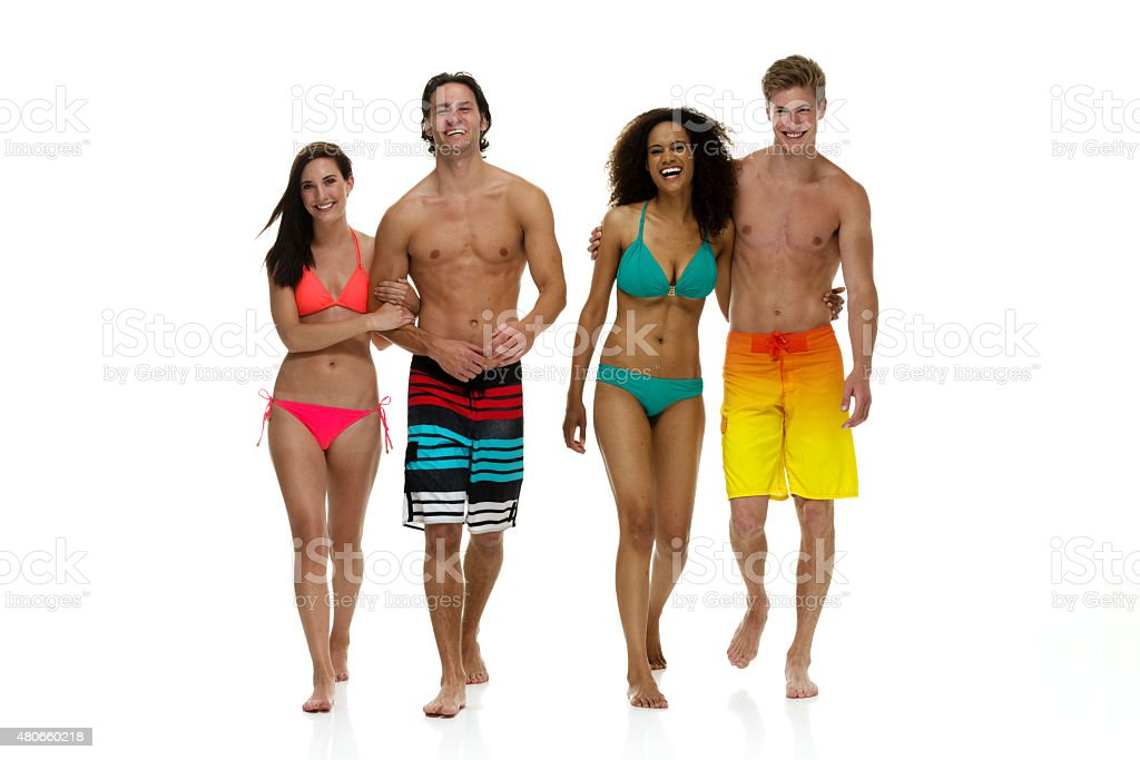 Group of friends walking in swimwear stock photo