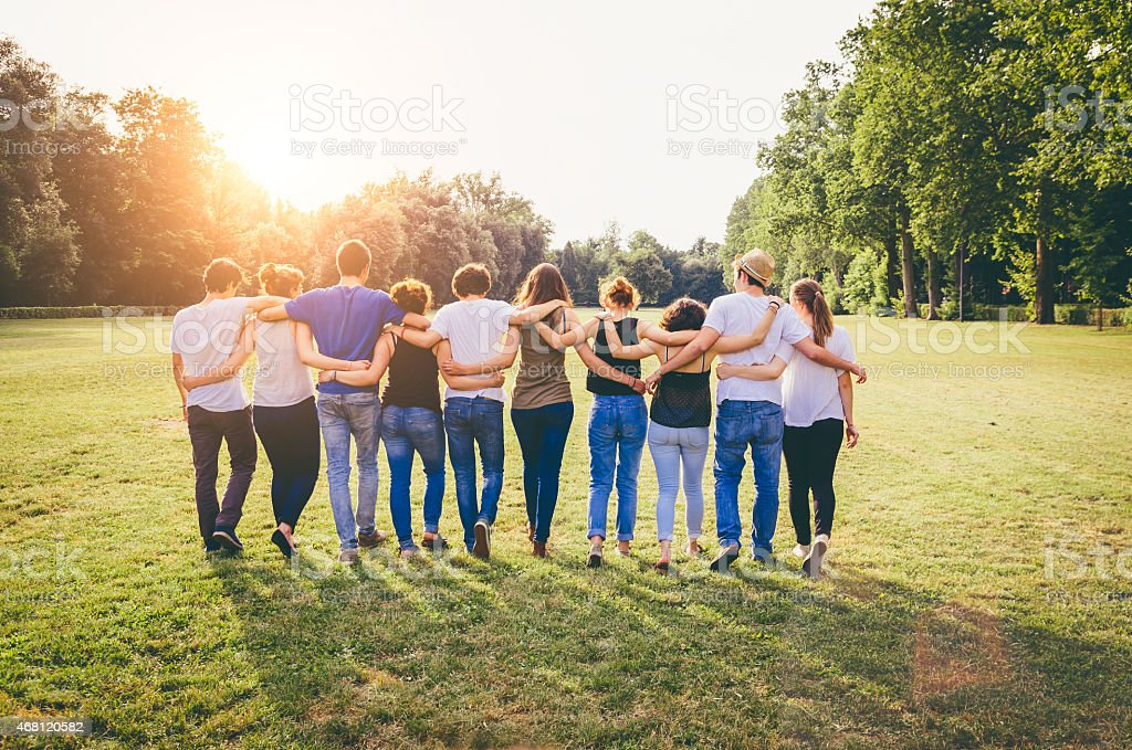 Group Of Friends Walking Together stock photo