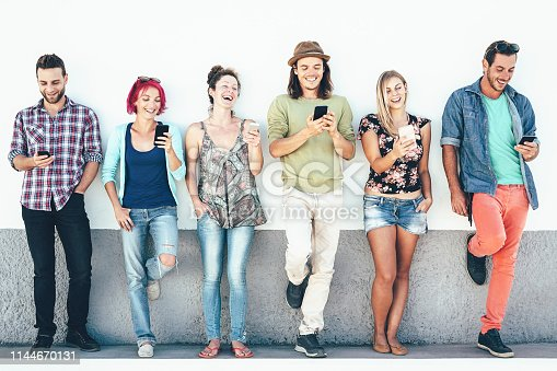 istock Group of friends watching on their smart mobile phones outdoor - Young generation having fun with new technology and social network - Concept of millennial people, tech and youth lifestyle 1144670131