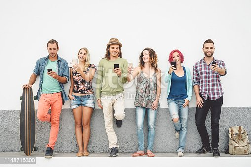 istock Group of friends watching on their smart mobile phones outdoor - Young millennial people having fun with new technology smartphones and social network - Concept of generation z, tech, youth lifestyle 1148715300