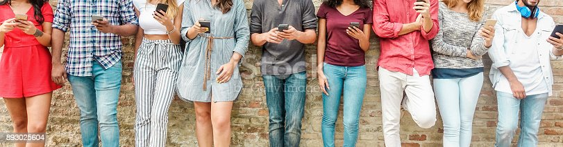 istock Group of friends watching smart mobile phones - Teenagers addiction to new technology trends - Concept of youth, tech, social and friendship - Main focus on center hands 893025604
