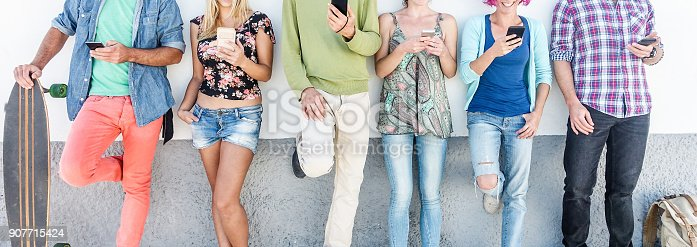 istock Group of friends watching smart mobile phones - Teenagers addiction to new technology trends - Concept of youth, tech, social and friendship - Main focus on center hands 907715424