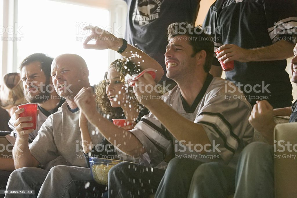 Group of friends watching sports on tv royalty-free stock photo