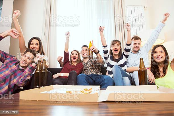Group of friends watching tv match and cheering picture id512727882?b=1&k=6&m=512727882&s=612x612&h=c1x7etc92uo3ssvxiwuk06mr5dkmvbtsxmigkdokyw8=