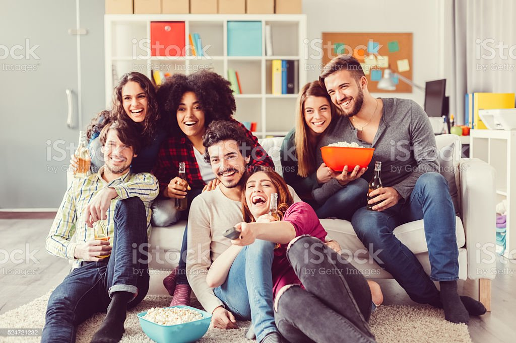 Group of friends watching tv stock photo