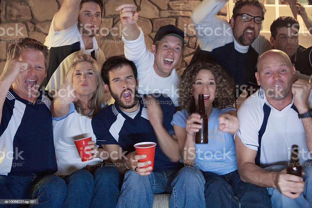 Group of friends watching tv royalty-free stock photo