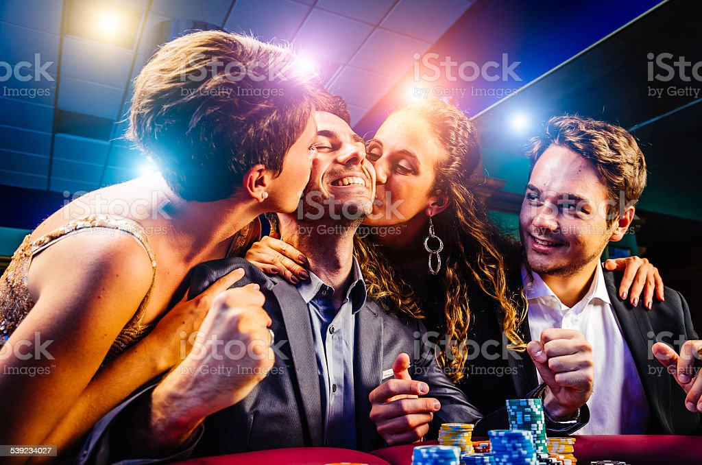 Group of friends winning at Casino royalty-free stock photo