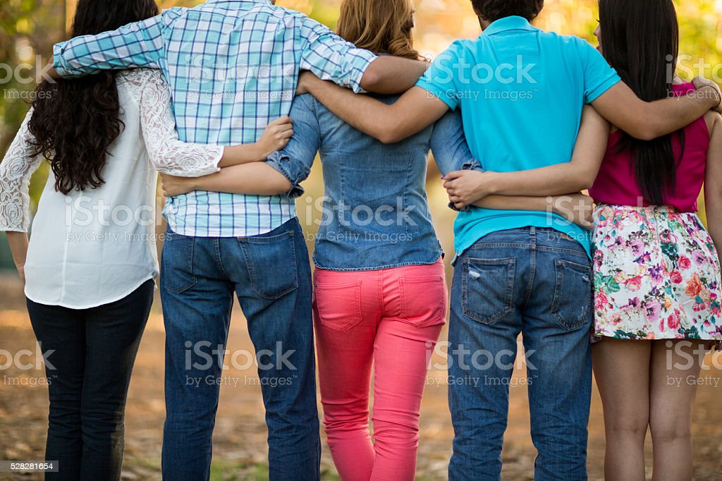 Group of friends with backs to camera stock photo