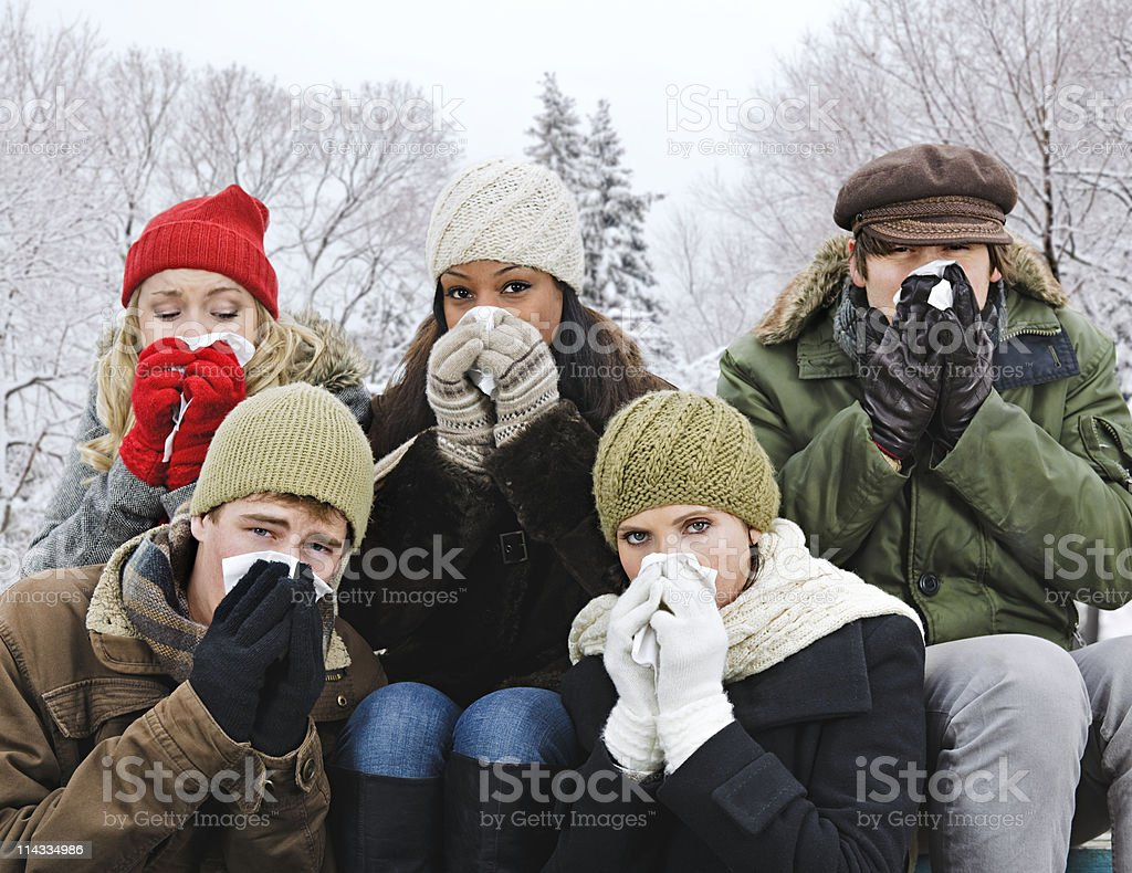 Group of friends with colds outside in winter royalty-free stock photo