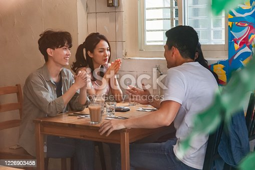 A group of friends with drinks at a resterant. Young people are enjoying