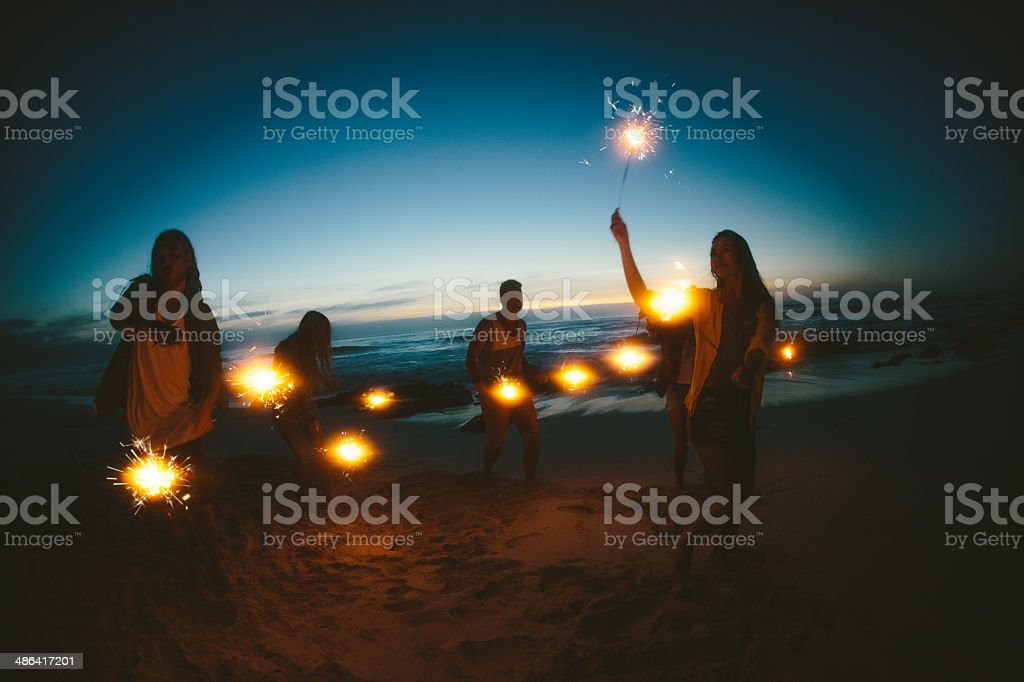 Group of friends with fireworks stock photo