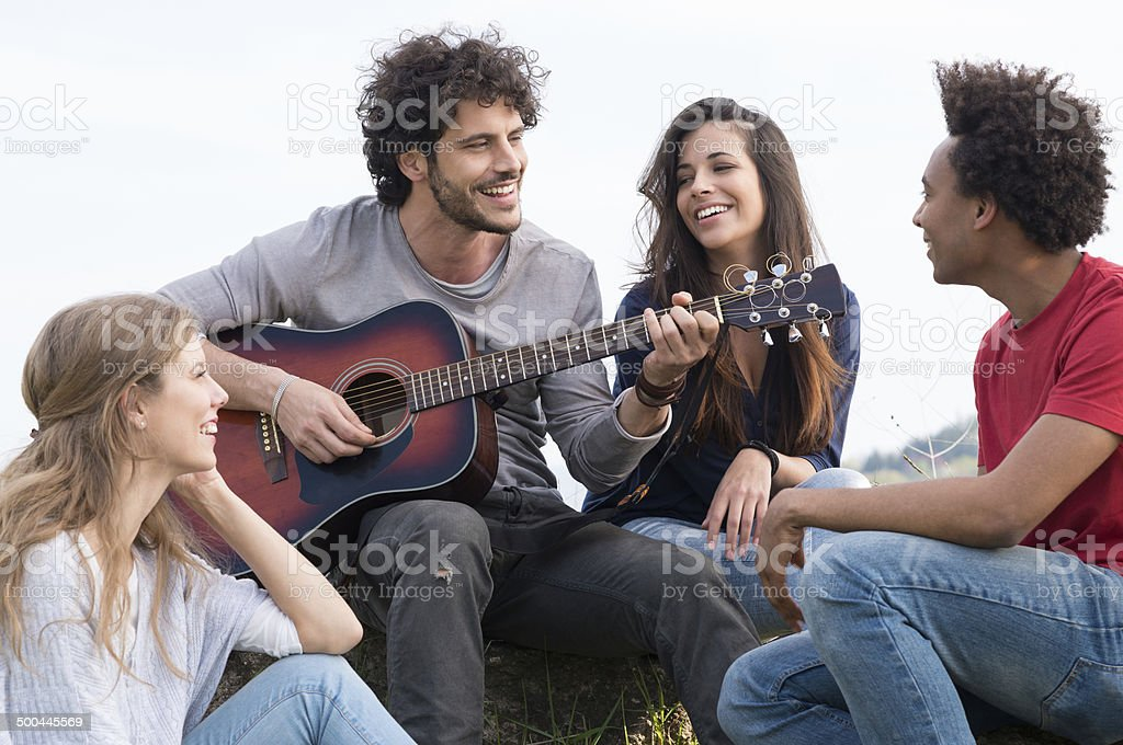 Group Of Friends With Guitar stock photo