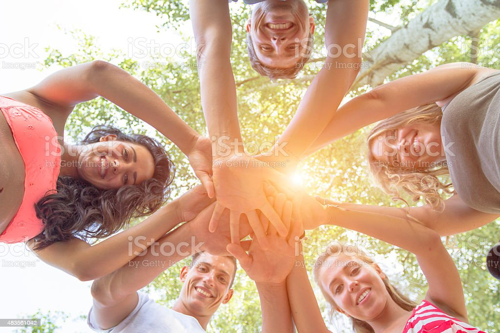 Group of Friends with hands in hands stock photo
