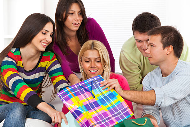 Group of friends with shopping bags Group of friends with shopping bags after shopping. group of friends giving gifts to the birthday girl stock pictures, royalty-free photos & images