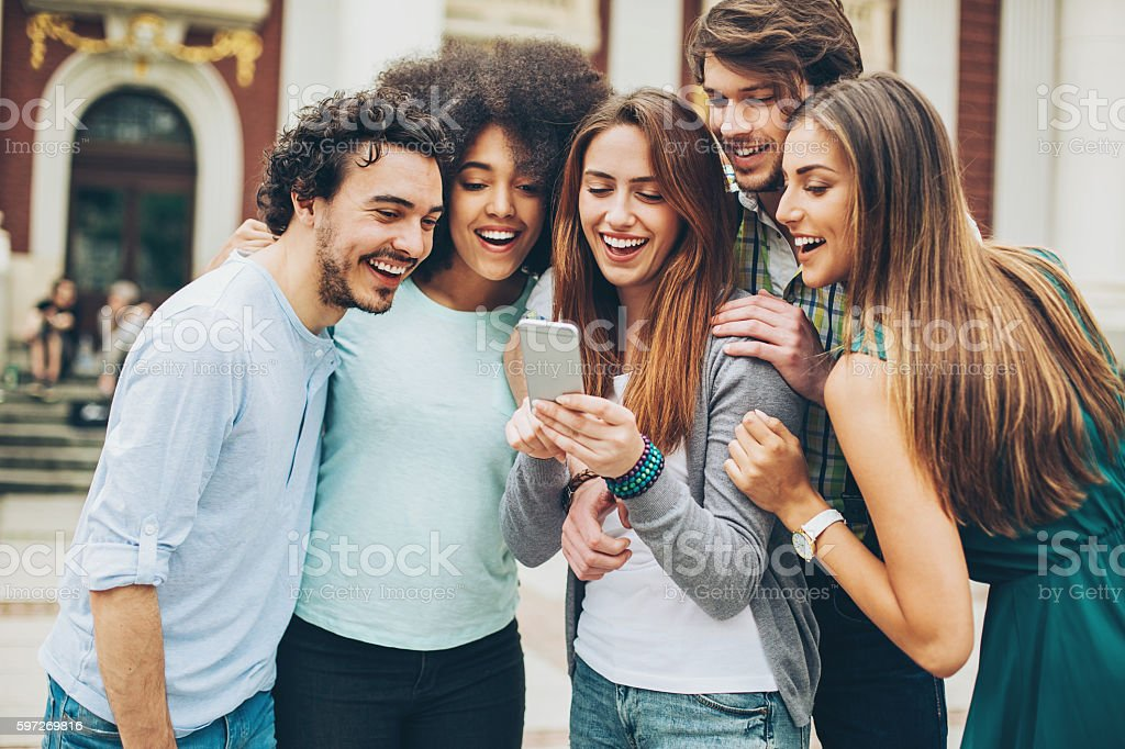 Group of friends with smart phone royalty-free stock photo
