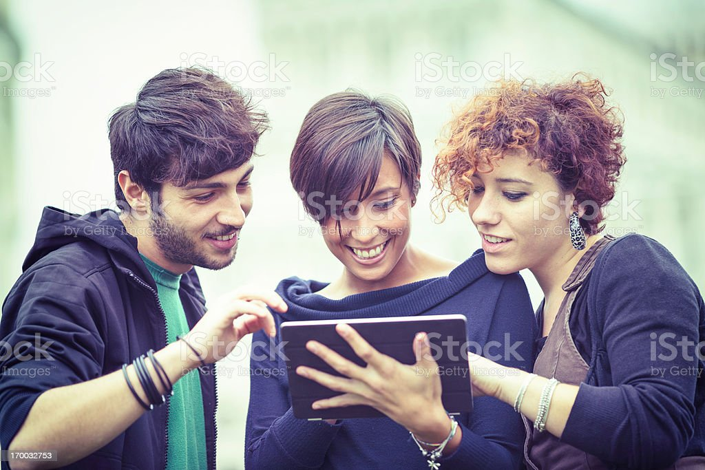 Group of Friends with Tablet PC Outside royalty-free stock photo