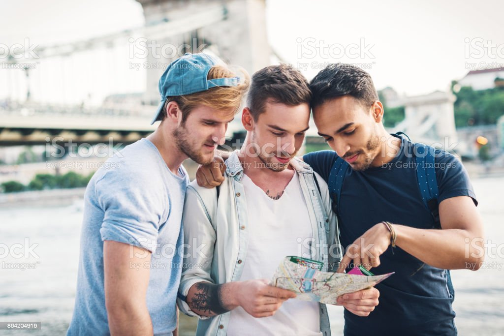 Group of gay tourists traveling together royalty-free stock photo