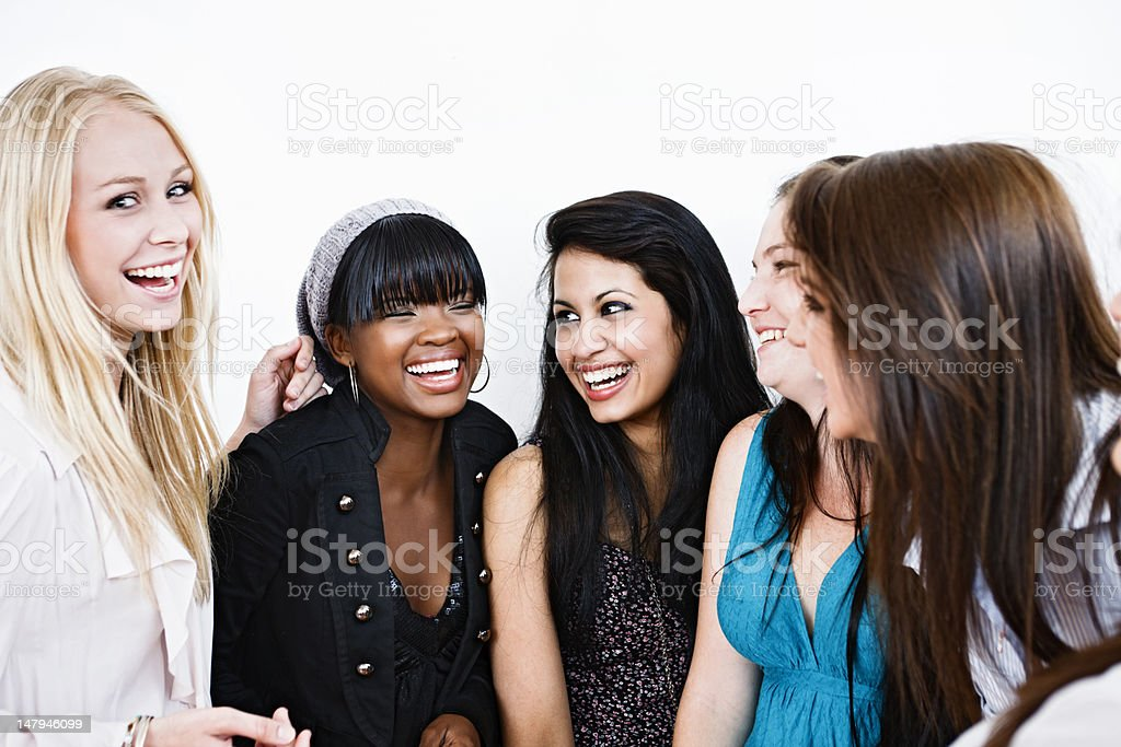 Group of girlfriends laugh together stock photo
