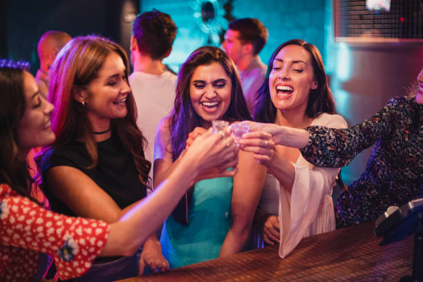 Group of Girls about to take some shots Friends about to take a shot on their ladies night out. tequila shot stock pictures, royalty-free photos & images