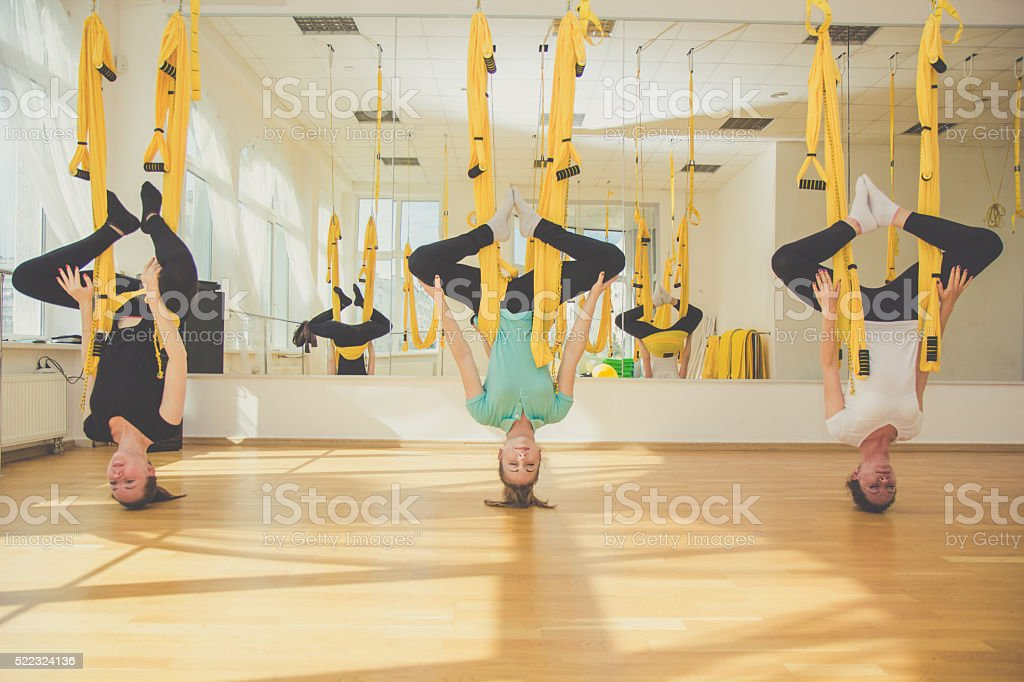 Group of girls doing aerial fly yoga stock photo