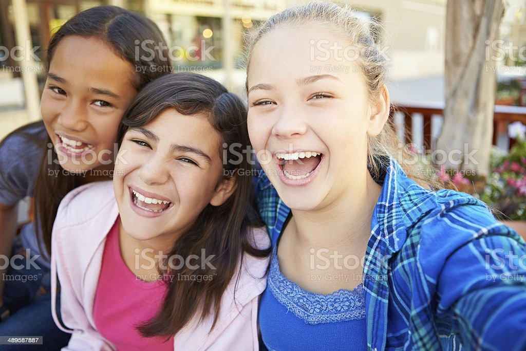 Group Of Girls Hanging Out In Mall Together stock photo