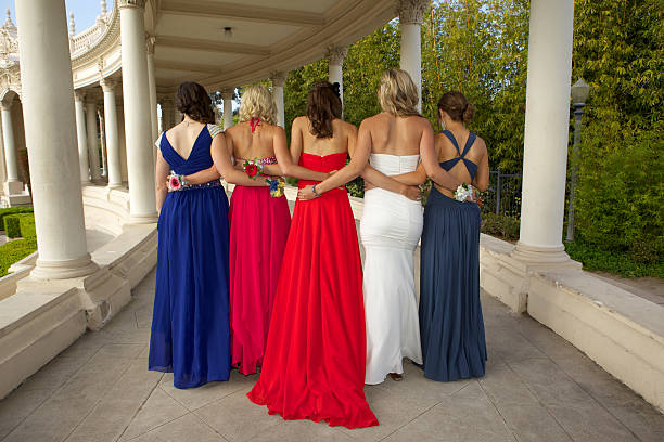 group of girls in prom dresses rear view - prom stock photos and pictures