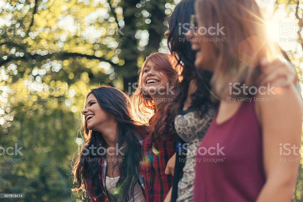 Group of girls in the park stock photo