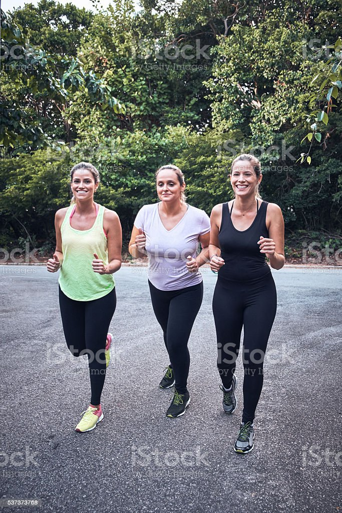 Group of girls jogging stock photo