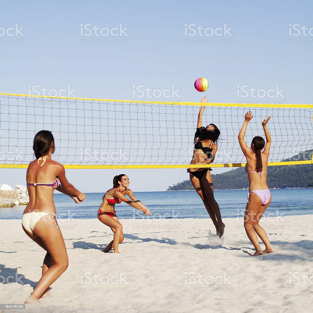 Group of girls playing beach volleyball royalty-free stock photo