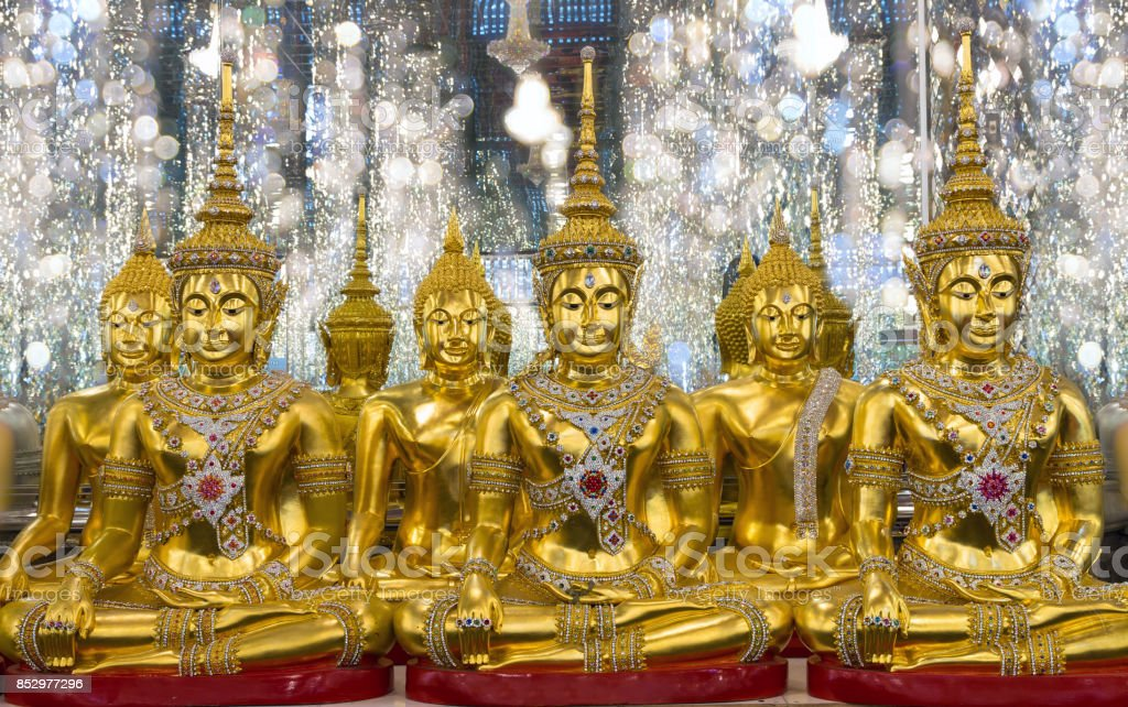 group of Golden Buddha statue in Cathedral glass, Thasung Temple, Thailand, public domain stock photo