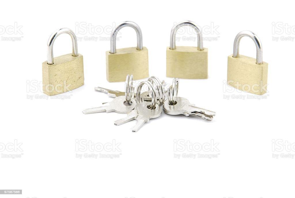 Group of golden closed padlocks with keys on white royaltyfri bildbanksbilder