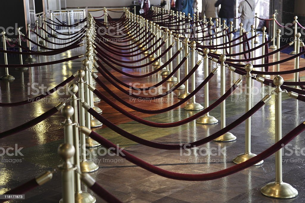 group of golden poles with rope royalty-free stock photo