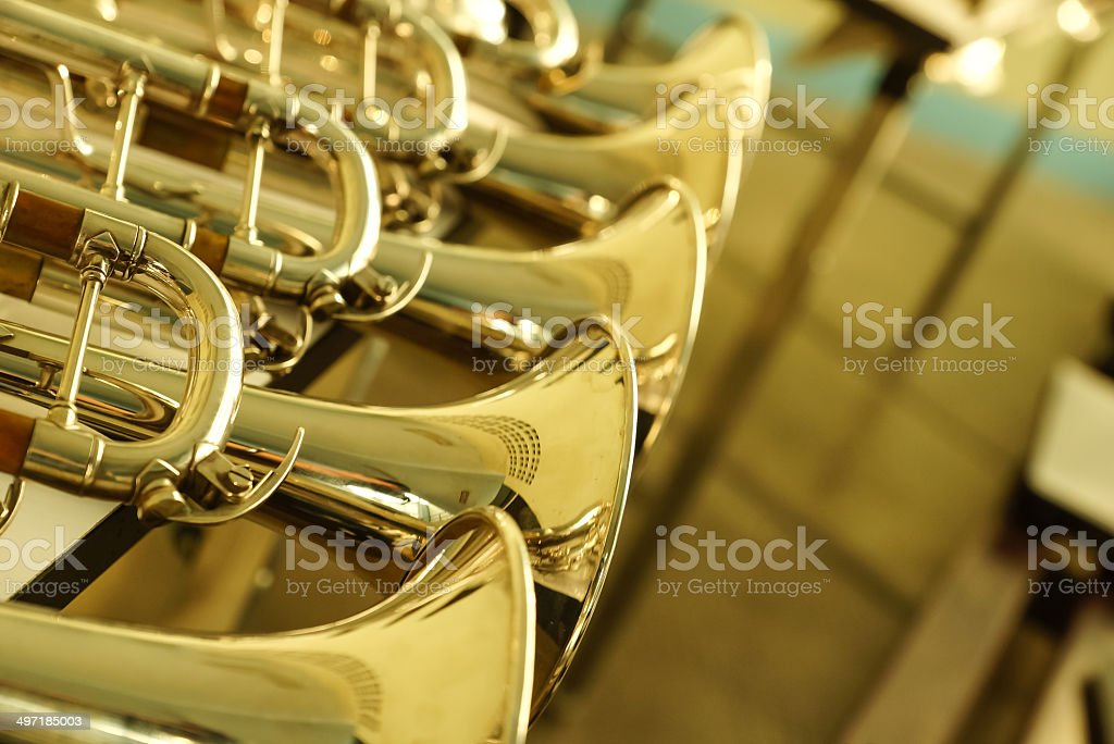 Group of golden trumpets. stock photo