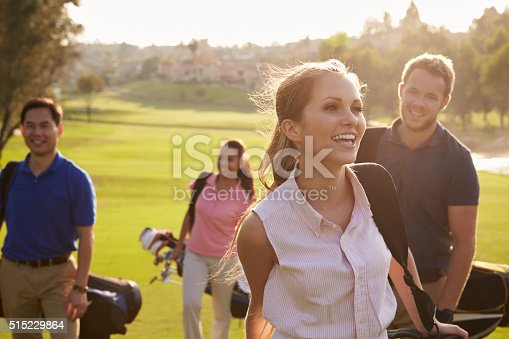 istock Group Of Golfers Walking Along Fairway Carrying Golf Bags 515229864