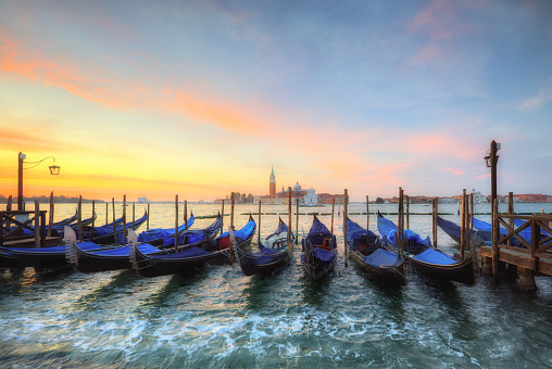 Group of gondolas moored by Saint Mark square