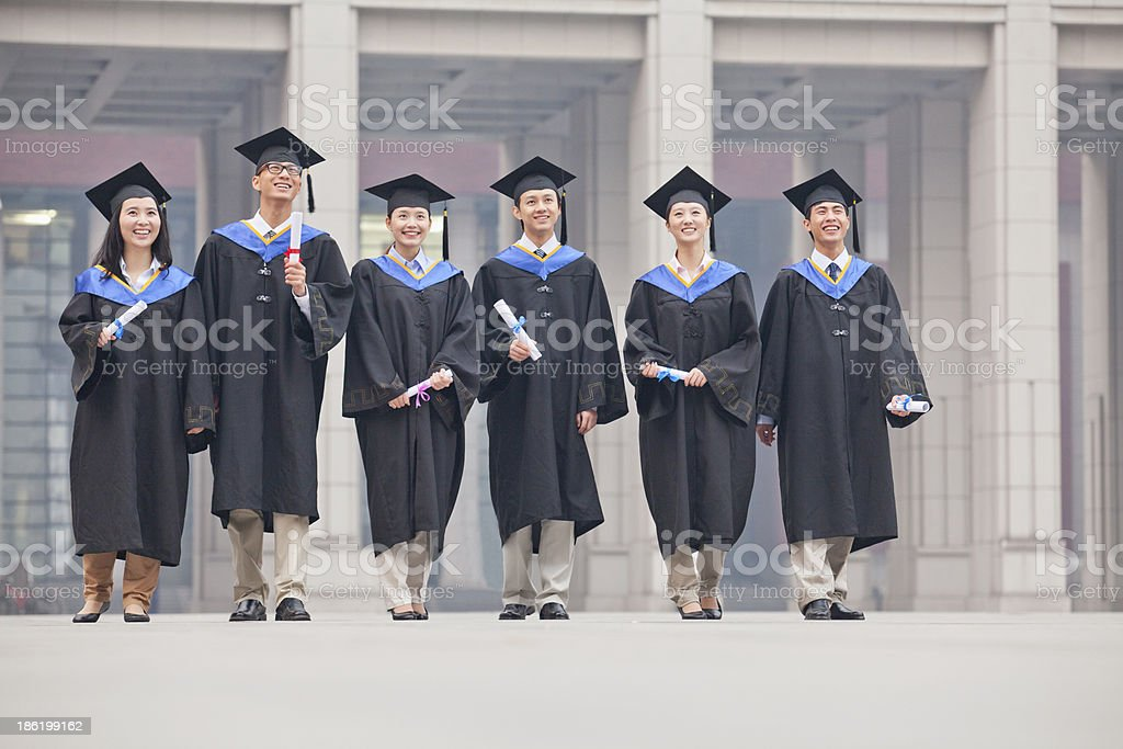 Group of Graduate Students Standing with Diplomas stock photo